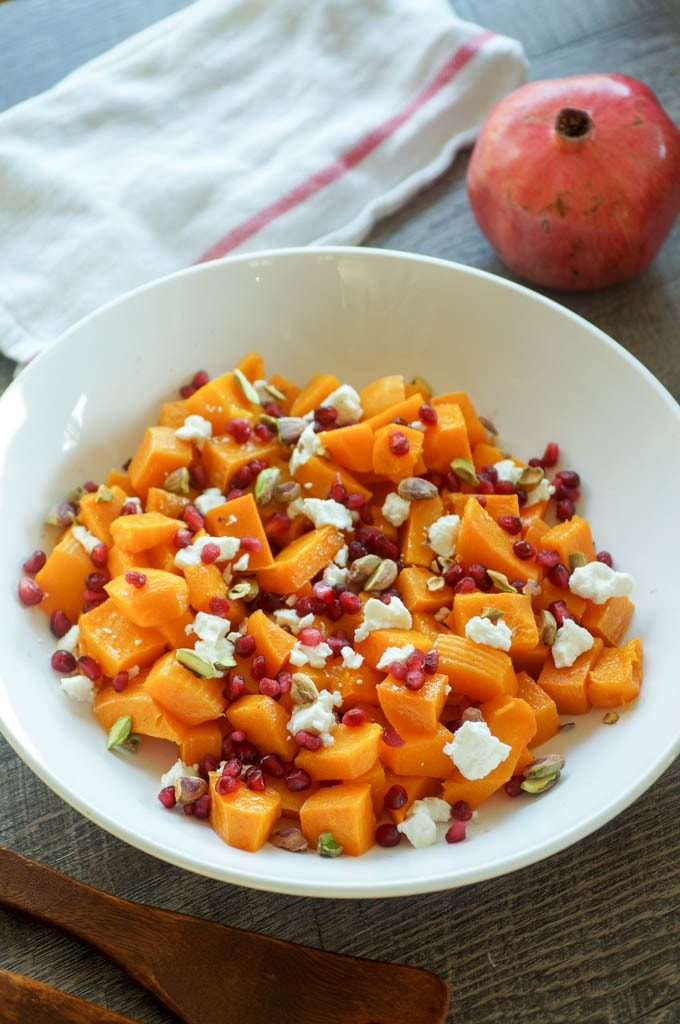 Roasted Butternut Squash with Pomegranate and Pistachios is an easy and unexpected holiday side dish. Goat cheese adds tang to this 5 ingredient, 1 pan dish! #butternutsquash #thanksgiving #holiday #sidedish #vegetarian
