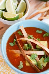 leftover turkey tortilla soup, crispy tortilla strips, lime garnish. Creative Thanksgiving leftovers.