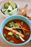 leftover turkey tortilla soup, crispy tortilla strips, lime garnish
