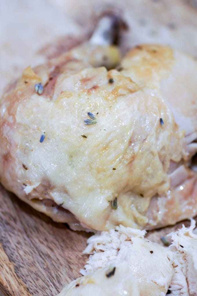 Chicken thigh on cutting board with lavender