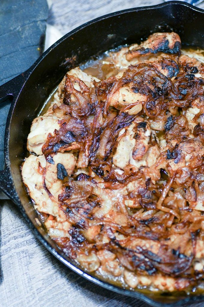 Easy French Onion Chicken tops juicy chicken thighs with sweet and savory caramelized onions. One pan, 7 ingredients, weeknight dinner. #onepan #weeknightmeal #easydinner #frenchonion