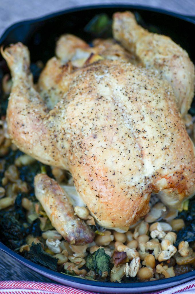 Roasted Chicken with Greens and Beans is a warm, comforting, one-pan dish just bursting with flavor. Garlic, lemon, and thyme flavor juicy chicken, Swiss chard, and white beans. #roastedchicken #onepan #top8free #allergenfree