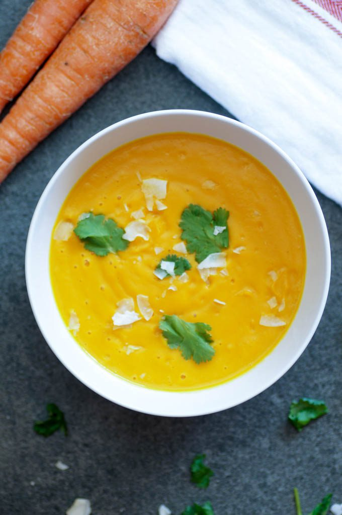 Squash and carrot soup is elevated with fragrant ginger, garlic, and spices in this vegan dish. It will only take a few easy steps in the Instant Pot to make this soup taste like it's been simmering all day.