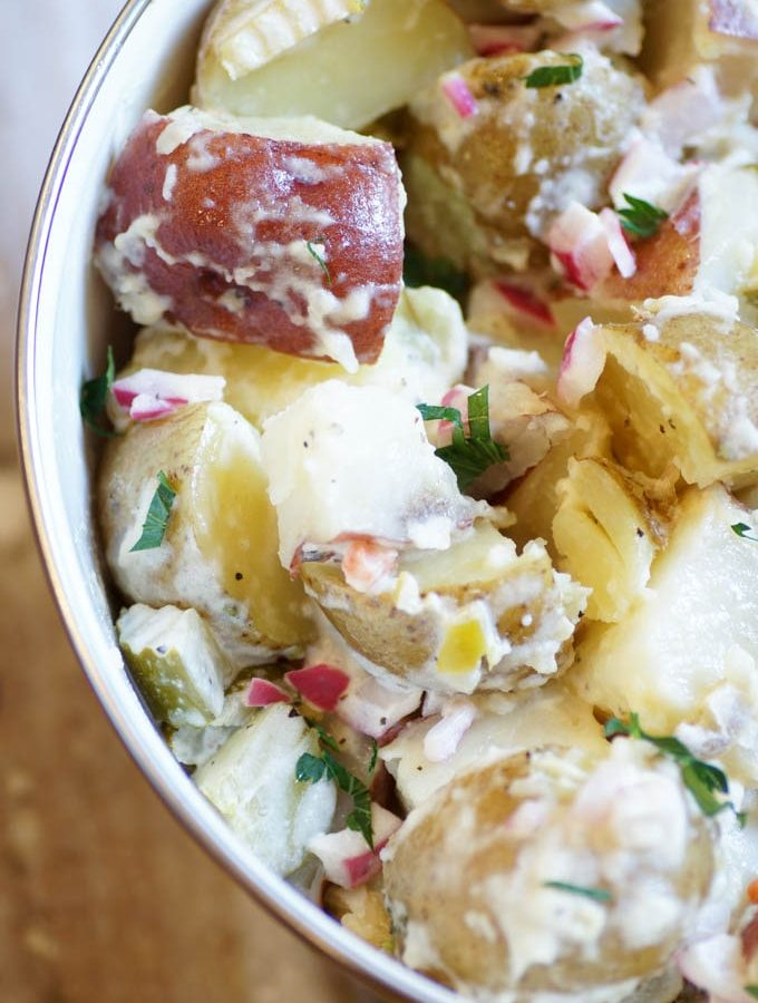 A tangier, lighter, spicier take on traditional potato salad, with dill pickles and giardiniera. #potatosalad #picklepotatosalad #pickles #giardiniera #whitecoatpinkapron
