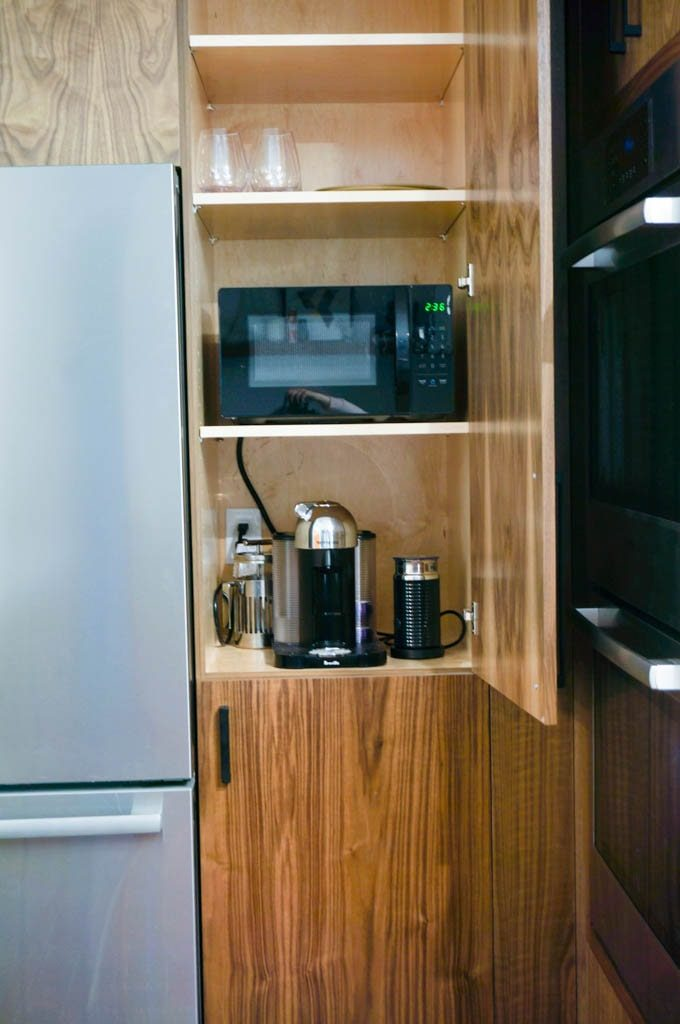 Hiding appliances in the kitchen is a great way to keep a clean, modern aesthetic. #hiddenappliances #hiddenmicrowave #kitchenrenovation #whitecoatpinkapron
