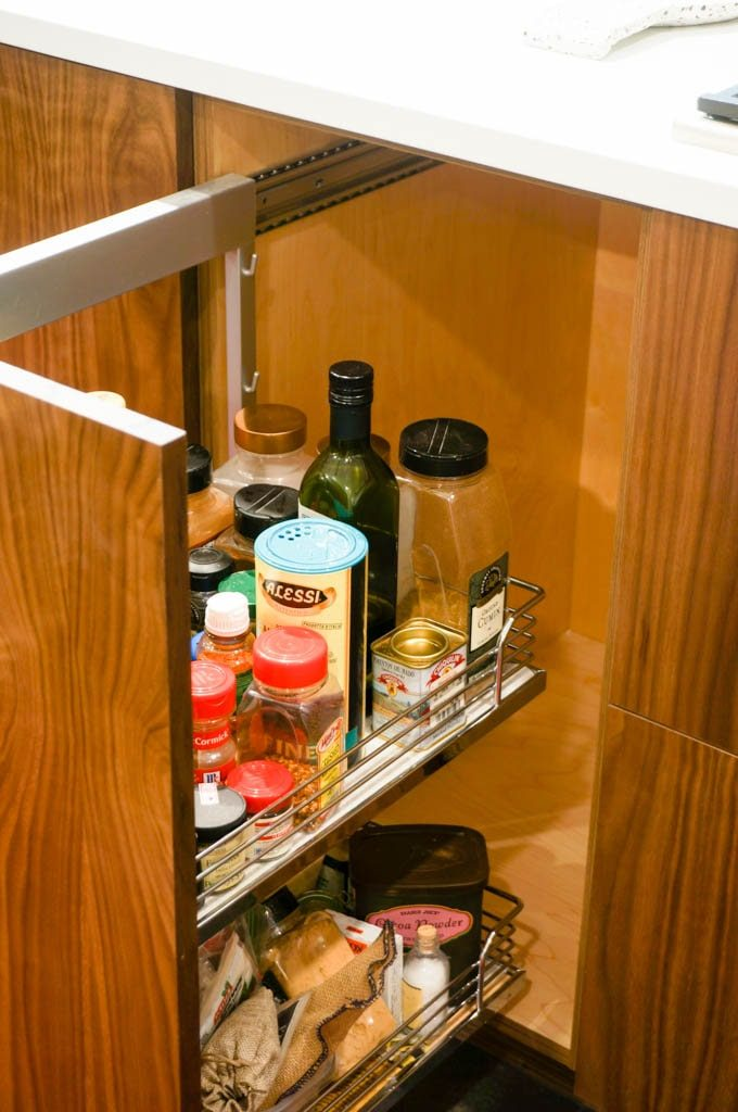 A kitchen spice cabinet makes finding spices so easy! #kitchenrenovation #spicecabinetideas #whitecoatpinkapron