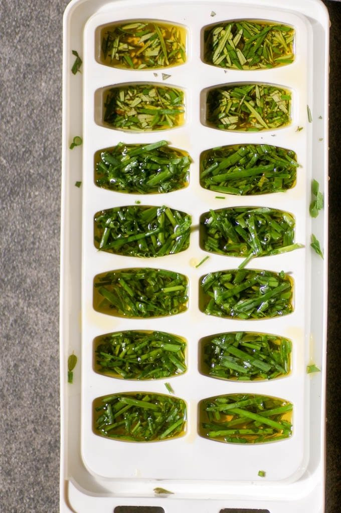 Herbs and olive oil in ice cube trays