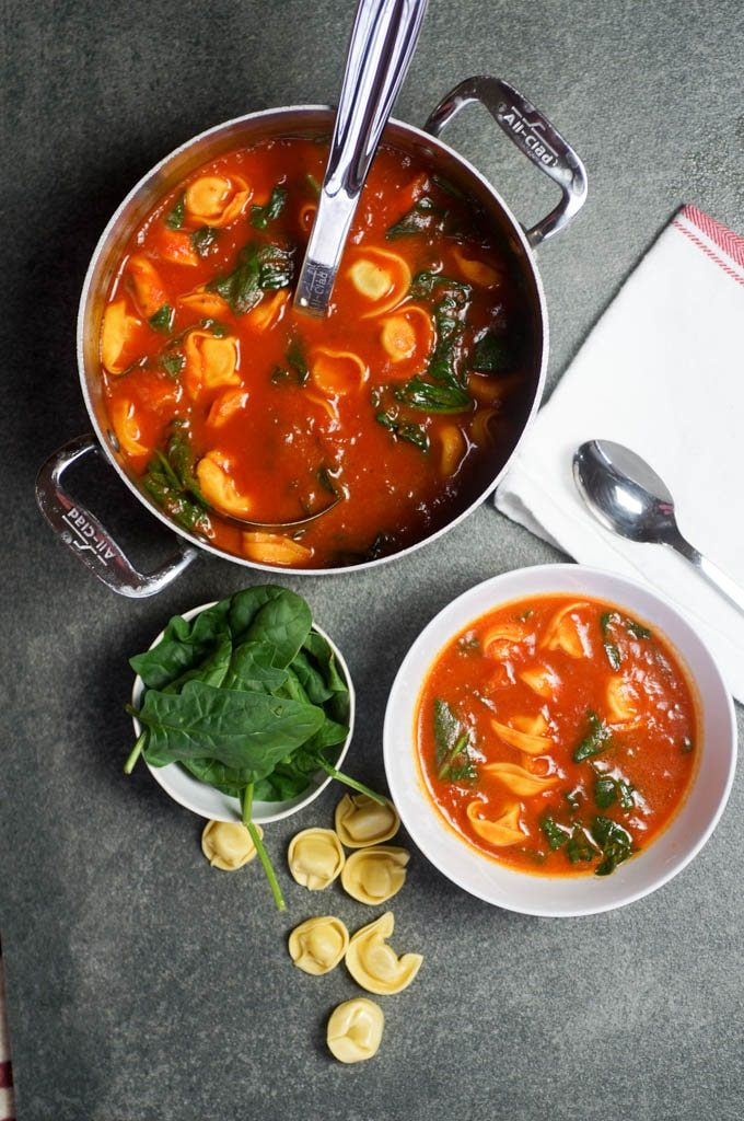 Easy Vegetarian Tortellini Soup is an incredibly flavorful 3 ingredient weeknight meal that takes only fifteen minutes from start to finish. #whitecoatpinkapron #vegetariansoup #vegansoup #easytortellinisoup